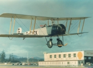 Golden Centennaires AVRO 504K in the original colours over the Pat Bay Airport. Photo by William Ewing