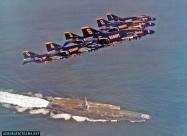 Blue Angels F-4J Phantom over aircraft carrier USS Enterprise