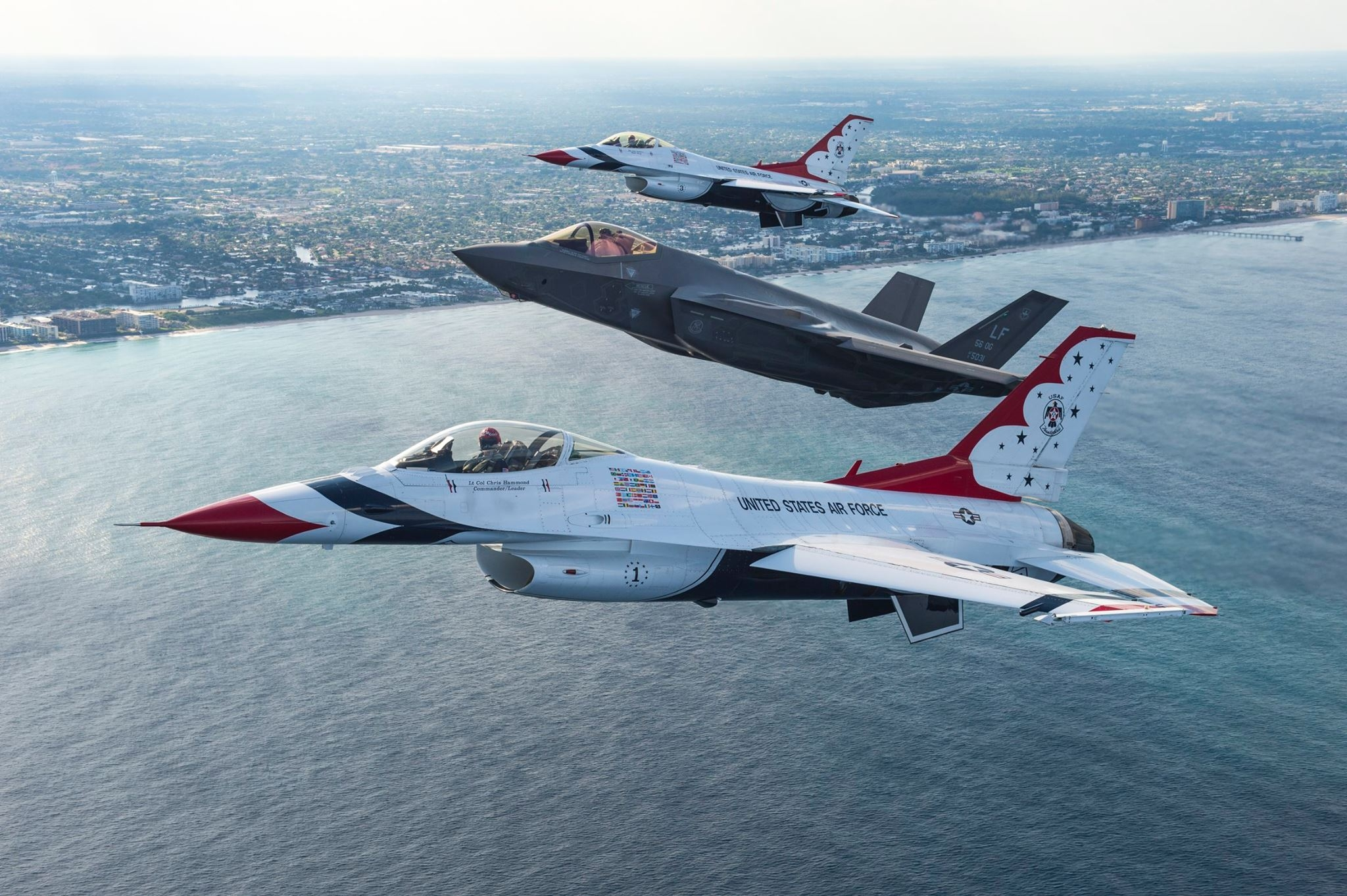 Thunderbirds and F-35A Lightning II in formation flight over Fort Lauderdale. Photo USAF