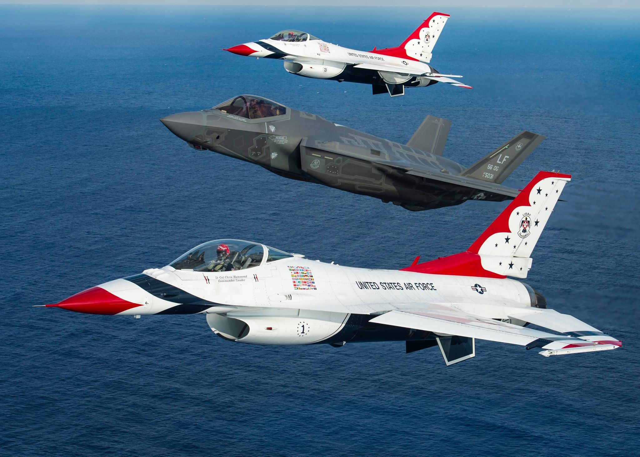 Thunderbirds and F-35A Lightning II in formation flight. Photo USAF
