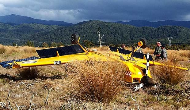 Overturned Red Checkers CT-4E aircraft