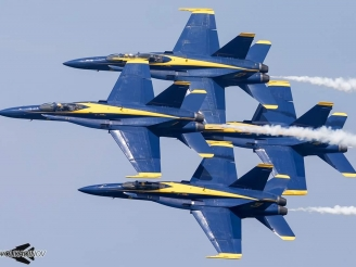 Two Blue Angels aircraft clash during a flight