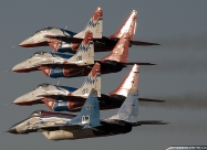 Swifts MiG-29 in formation with an aircraft in old livery