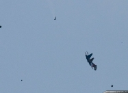 Russian Knights 2009 crash. Su-27UB after collision going to the groung