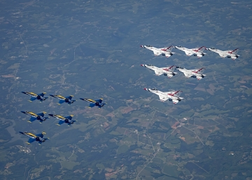 Thunderbirds and Blue Angels in joint flight heading to New York. U.S. Air Force photo/Staff Sgt. Cory W. Bush